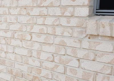 Bricklayers White Cement against cream bricks