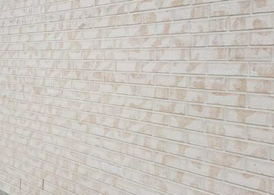 Cream sandstone brick wall with Bricklayers White Cement